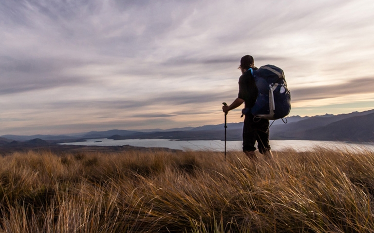 Hiker looking over lake and mountains